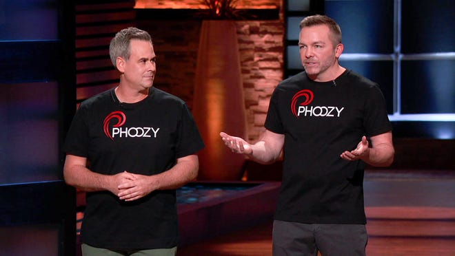 "Kevin Conway, left, and Josh Inglis, formerly of Stark County, will appear on the popular television show ""Shark Tank"" on Friday. The pair founded PHOOZY, a company specializing in thermal capsules designed to protect cellphones from exposure to heat and cold."