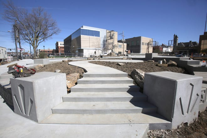 One of the new elevated seating areas is pictured at Massillon's Duncan Plaza, where a major remodeling effort is ongoing. Construction workers were setting concrete blocks Tuesday at the downtown spot, which will host a summer concert series this year.