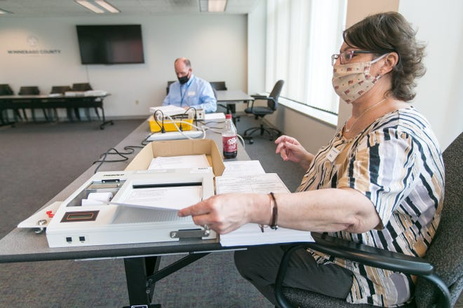Maria Rogers, chief deputy county clerk, tests the optical-scanning AccuVote machines at the Winnebago County Administrative Building in Rockford on Tuesday with a test deck of ballots to confirm machines accurately count and record ballots ahead of the April 6 election.