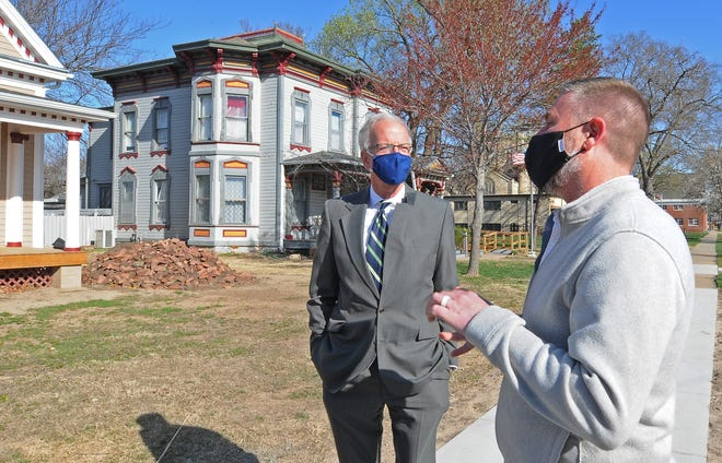 Sen. Jerry Moran, left, visits with Executive Director of the Ashby House Andy Houltberg outside of the current historical house that is being reconstructed to be emergency housing for the Ashby house during the visit by Moran on Tuesday morning.