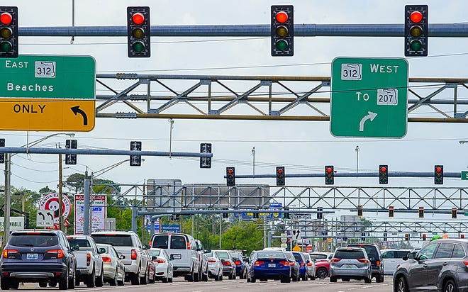 Vehicles pass through the intersection of U.S. 1 and State Road 312 on Tuesday, March 30, 2021.