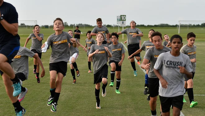 Youth members of the Lakewood Ranch Chargers Soccer Club practice in 2015 at Premier Sports Campus. The sporting facility will host the US Youth Soccer National Championships this July.