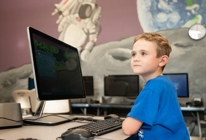 Harvey, 7, a member of the Lee Wetherington Boys & Girls Club, loves technology and dreams of becoming a mechanical engineer.