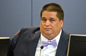 Former Sarasota County School Board member Eric Robinson is suing a consultant who worked for his opponent's campaign.