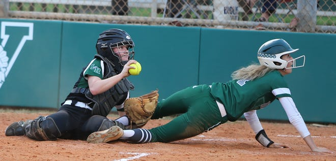 Lakewood Ranch catcher Gracie Hogie shows the umpire the ball after tagging out Venice's Megan Hanley at the plate during Monday's game.
