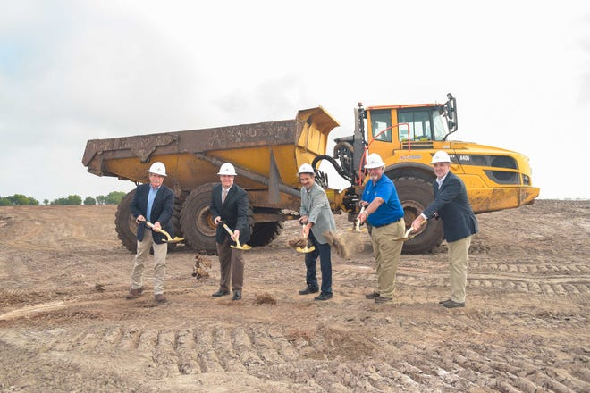 Robert Price, left, Tony Squitieri, Tony Chiofalo, John Barnott and Tim Martin break ground March 23 at the site of Star Farms, in Lakewood Ranch.