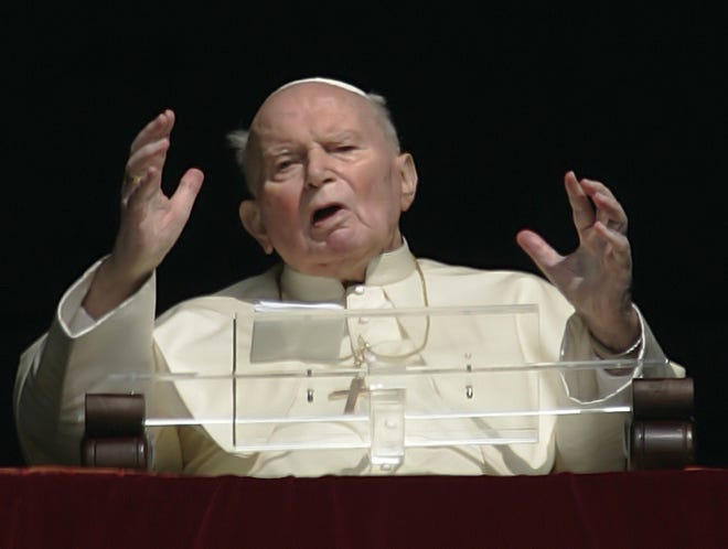 Pope John Paul II appears from his studio window overlooking St. Peter's square at the Vatican, Wednesday, March 30, 2005. The pontiff blessed the pilgrims gathered in St. Peter's Square and tried to speak, but the words were not clear. Pope John Paul II passed away April 2, 2005, at age 84.
