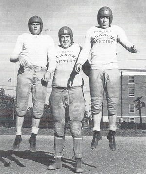 Big Ed Thompson, 225-pound OBU tackle, got into condition by lifting two of his teammates on the championship Bison football team. On the left was Darwin Richardson, right was quarterback Johnny Denton. OBU Trustees voted in December of 1940 to drop the sport.