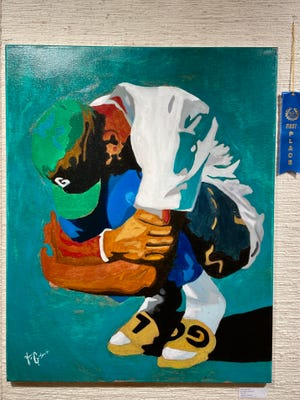 """First place went to Bethel High School's Tragan Goodnight for oil painting, """"Lost Flower Boy."""""""