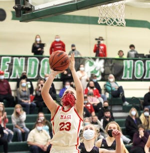 Reese Williams rises up to score the game-winning shot for Colon against Michigan Lutheran on Monday.