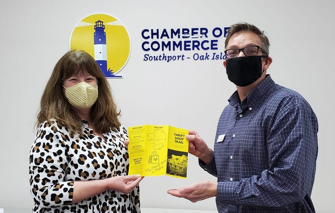 Karen Sphar, Southport-Oak Island Area Chamber of Commerce, and Todd Beane, CIS Thrift Shop Operations Director holding a copy of the Thrift Shop Trail brochure.