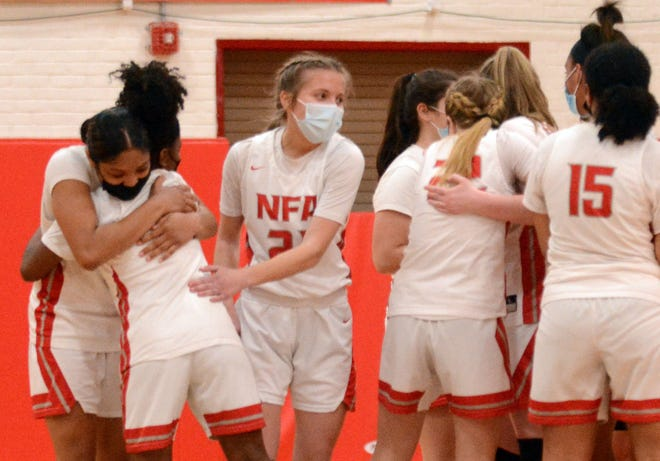 NFA players celebrate their 57-33 ECC South Tournament Final win over Waterford in Norwich.