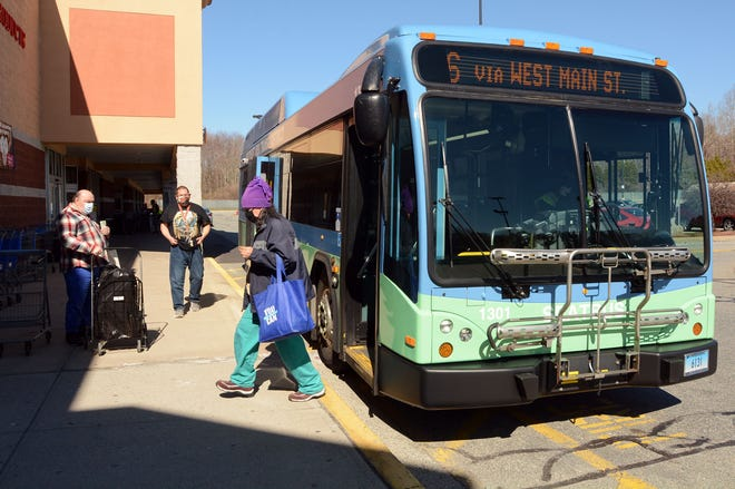People get off and on the SEAT bus Tuesday at WalMart and Big Y in Norwich.
