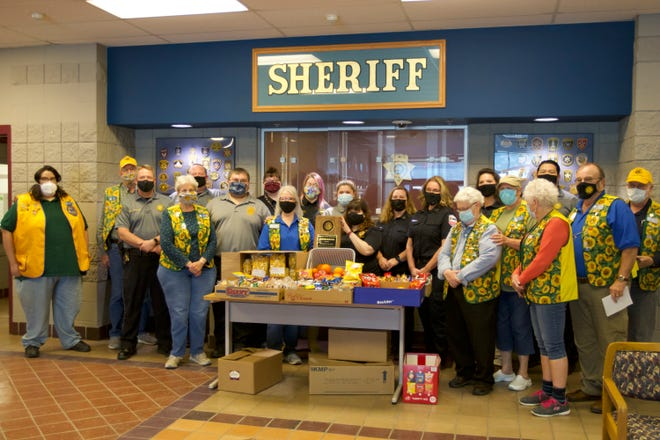 The Shawnee County dispatchers received a donation of snacks and a wall plaque Monday from the Sunflower Lions Club.