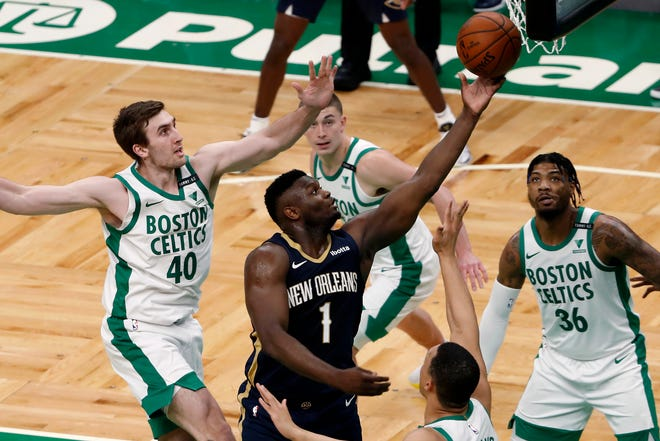 Pelicans forward Zion Williamson (1) drives to the basket as Celtics center Luke Kornet (40) and guard Marcus Smart (36) look on during the second quarter Monday night at TD Garden.