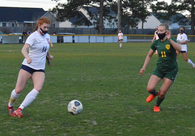 Terry Sanford's Kara Walker (14) and Pine Forest's Kahala Bandmann (11) have become exceptional leader for their girls' soccer teams. Both are hoping to cap their careers with a conference championship.