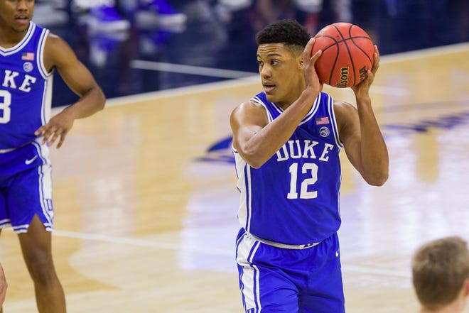 Duke's Patrick Tapé looks to pass during a game against Notre Dame in December. The 6-foot-9 Charlotte native is entering the transfer portal.