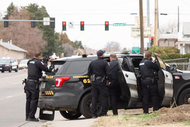 Pueblo Police stand outside a residence in the 1200 block of Van Buren Avenue during a standoff on March 30, 2021.