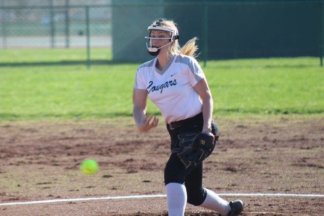 Westland senior Kayla Miller delivers a pitch during a five-inning 11-0 loss to Upper Arlington on March 29 at home. As a sophomore, Miller batted .486 and scored a team-high 22 runs to earn honorable mention all-league honors.