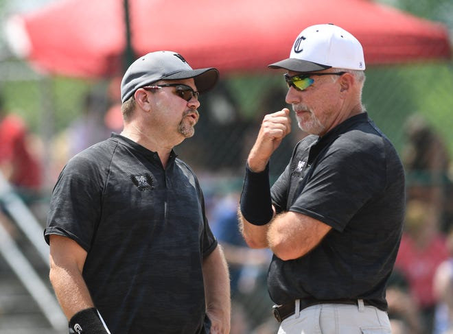 Central coach Brian Wamsley (left) and assistant Chip Linkhorn talk before the Warhawks' district final win in 2019. That season ended in a Division I state semifinal, and Central is working to again reach that level after the loss of numerous key players to graduation.