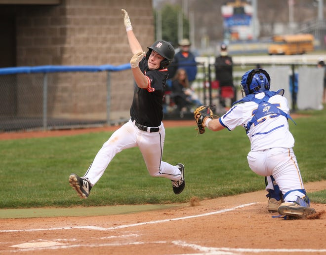 Delaware Hayes freshman Bryden Decaminada avoids Olentangy catcher Eric Efland to score in the visiting Pacers' 7-6 loss March 27. Decaminada expects to contribute at second base and third base.