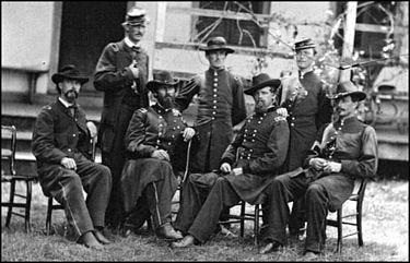 C.C. Walcutt is seated second from the right with his staff in 1864.