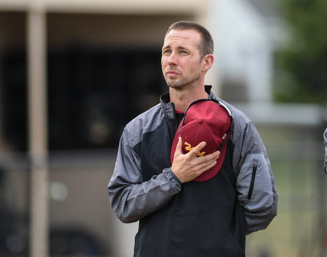 North baseball coach Sean Ring stands for the national anthem before a game in 2019. In his 11th seasonleading the Warriors, Ring has a roster short on varsity experience, but many players figure to contribute at multiple positions.