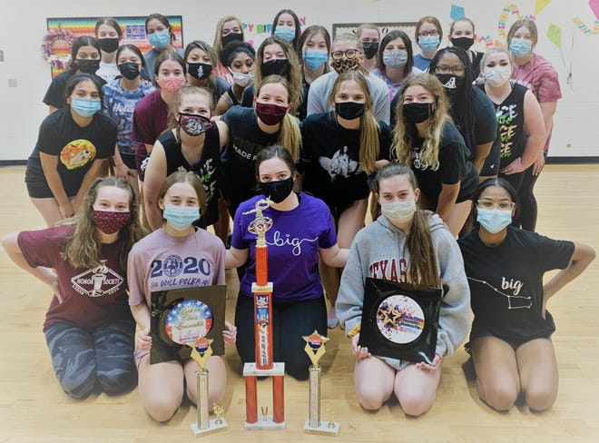 Members of the Ennis Lionettes display their awards won at area dance competitions this winter. The Lionettes will hold their year-ending spring show April 23-25.