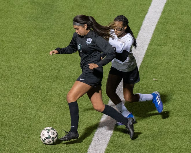 Waxahachie's Angel Garfias (9) dribbles during a 2020 home soccer match. Garfias recorded a hat trick on Friday night as the Lady Indians beat Bryan, 5-1, in the bi-district round of the Class 6A Region II playoffs at Waco Midway.