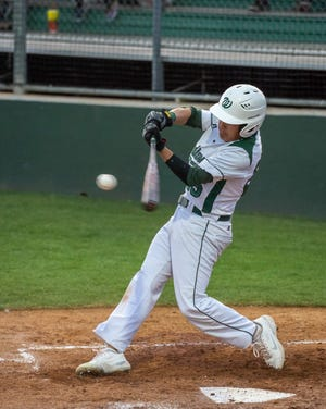 Waxahachie's Tanner Thompson makes contact during a recent home baseball game.