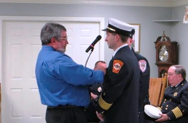 Easton's new fire chief, Justin Alexander, is shown above being sworn in as Plainville's chief in March 2014.  He's being pinned by his father, Donald Alexander, a former lieutenant for Raynham Fire.