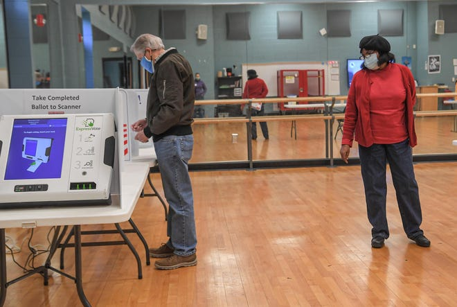 Poll manager Faye Wideman stands near Grant Lilly at a voting booth at Southwood Precinct during the Anderson County Council District 2 democratic primary special election voting Tuesday, March 30, 2021.