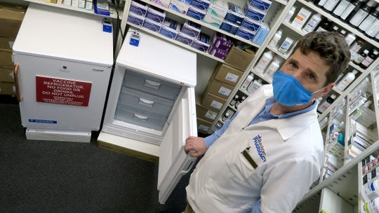 Richard Stryker, the owner and pharmacist at Bayshore Pharmacy in Atlantic Highlands, spent thousands getting ready to administer COVID vaccines, but his freezer is empty Tuesday, March 30, 2021, as supplies of vaccines are sent to mega-sites and hospitals.