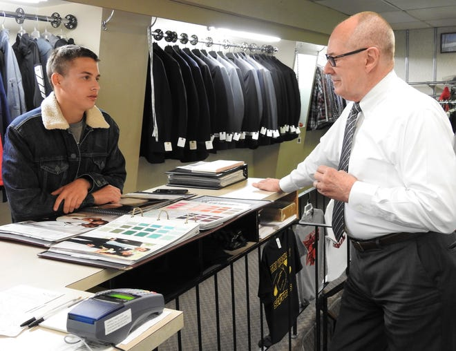Nathaniel Stamper of River View consults with Steve Murray of Carroll's Men Shop on renting a tuxedo for prom. Spring is a busy time for the store with proms and weddings. Murray said it was light last year because of the COVID-19 pandemic, but it's coming back this spring.