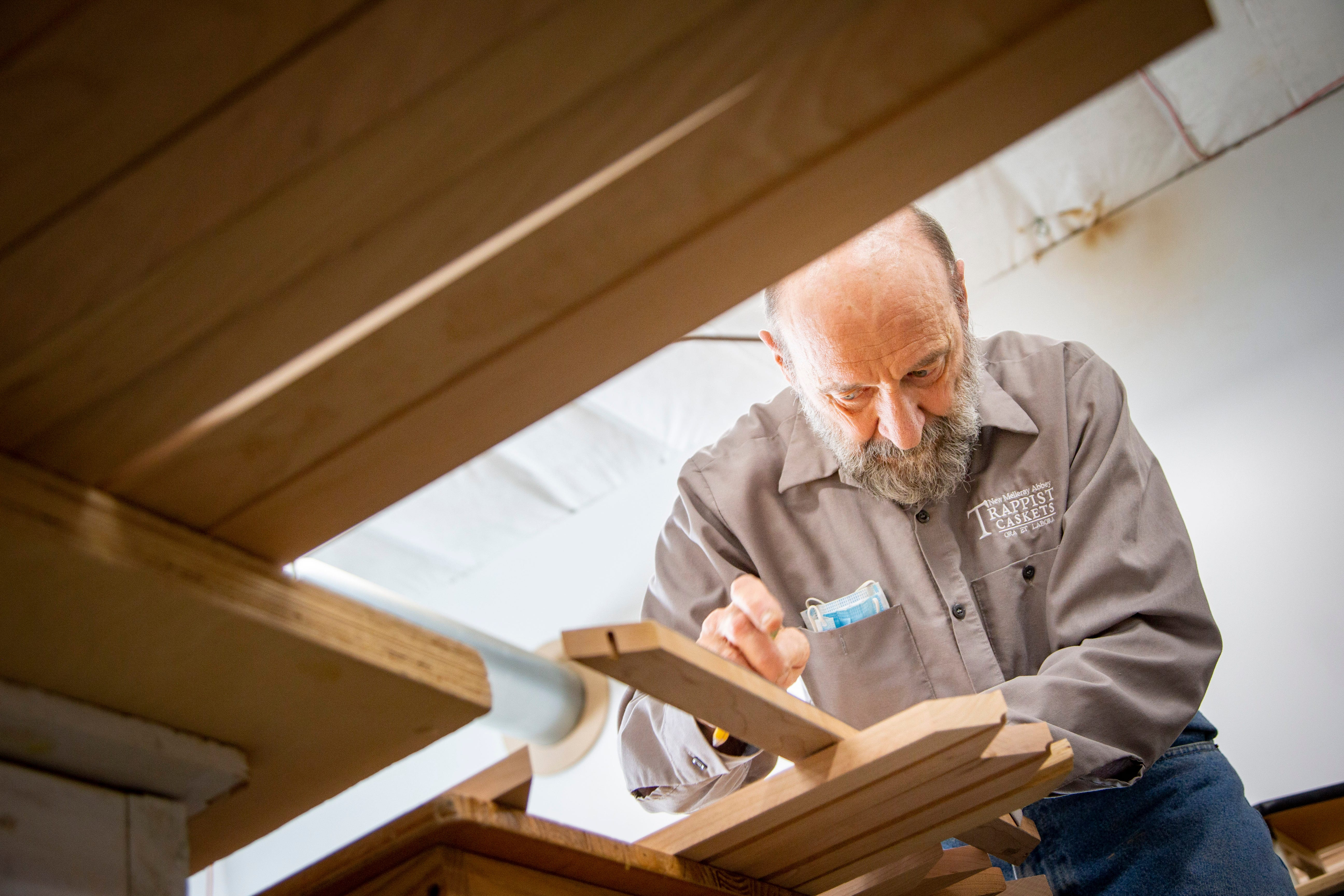 Trappist monk Brother Joseph Kronebusch hand-builds caskets in a workshop near the New Melleray Abbey southwest of Dubuque on March 16, 2021.