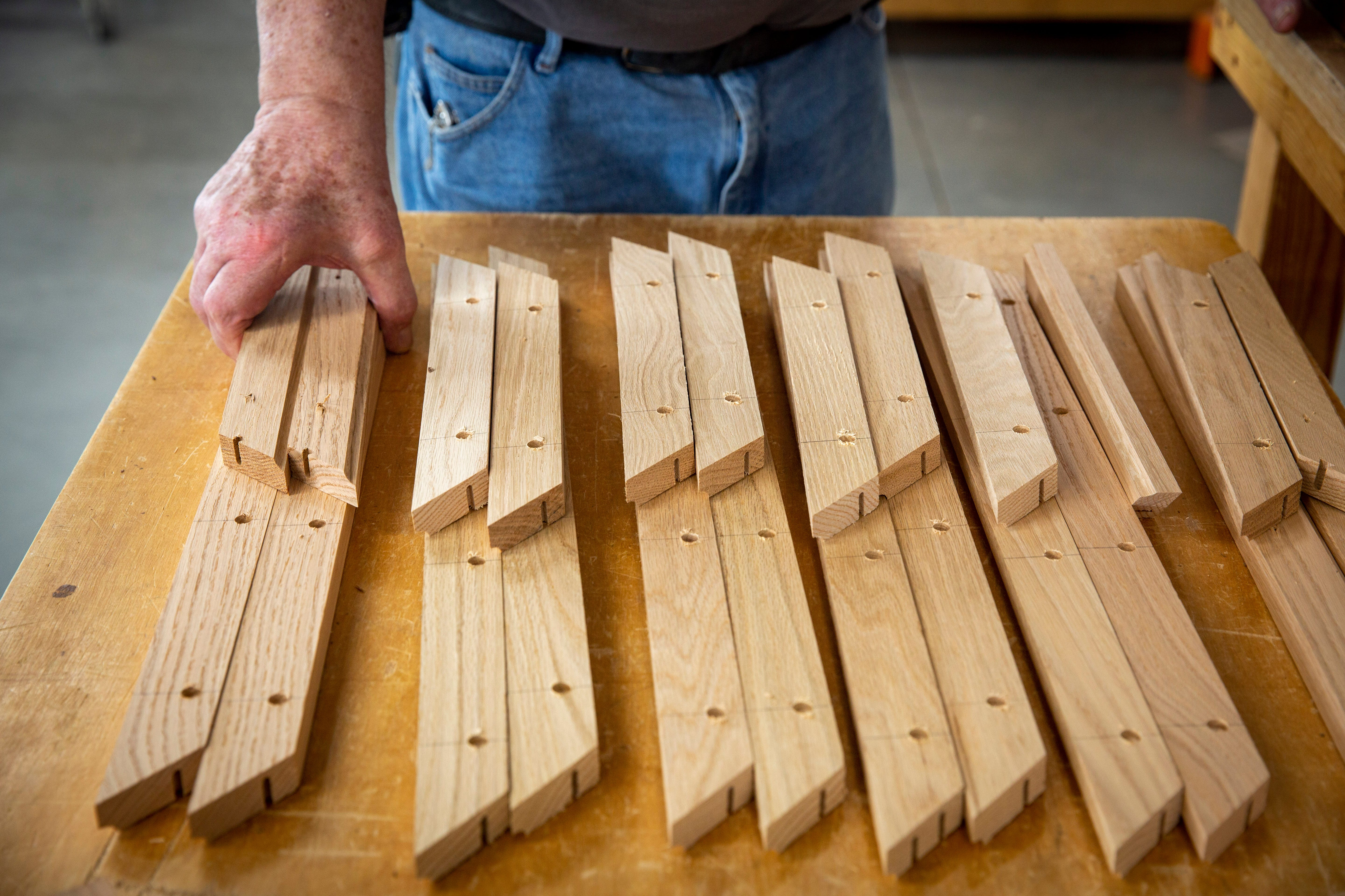 Denny Felton hand-builds coffins in the Trappist Casket workshop near the New Melleray Abbey southwest of Dubuque on March 16, 2021.