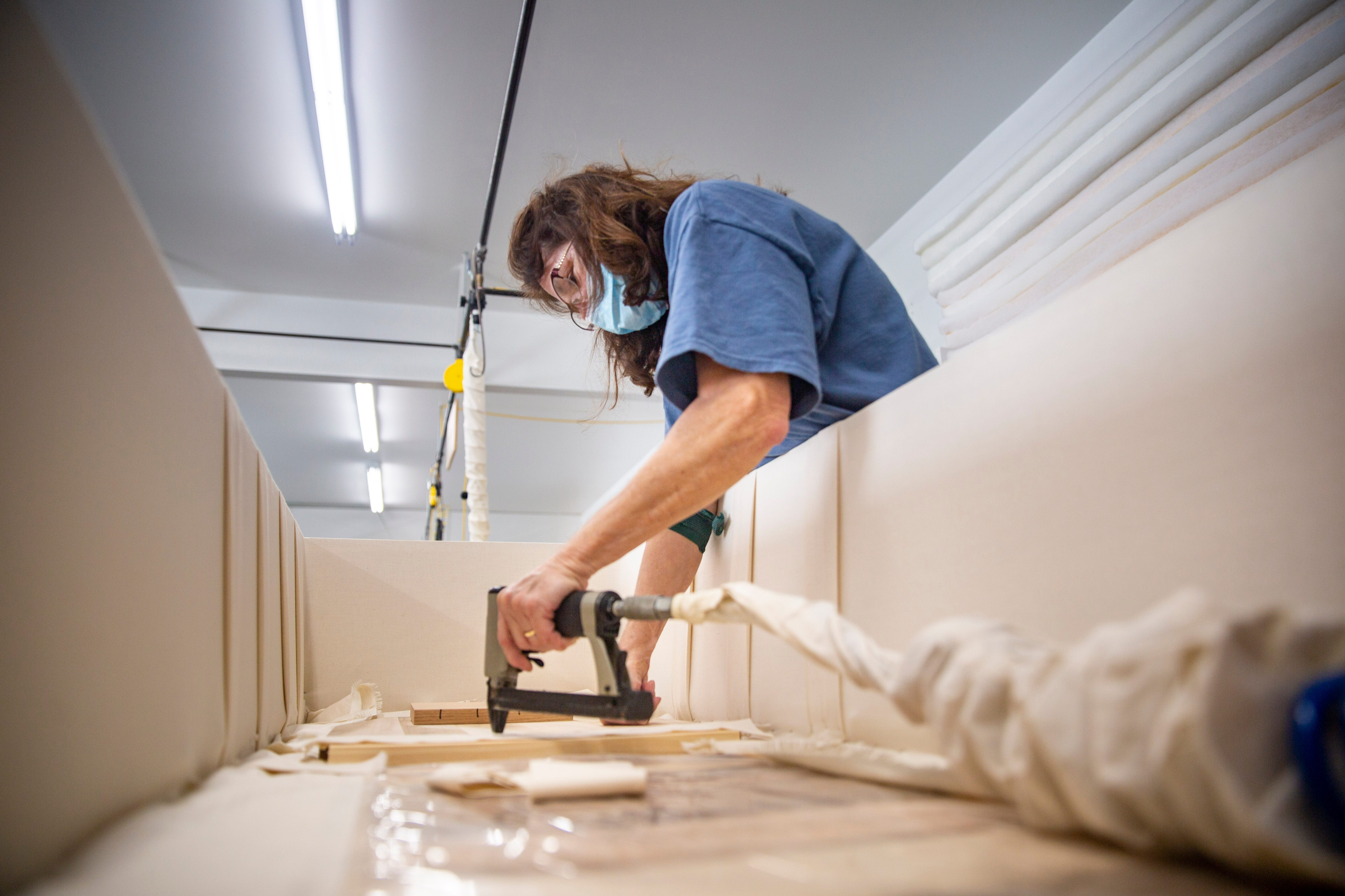 Upholsterer Cathy Freiburger builds the interior of a casket at the Trappist Caskets workshop at New Melleray Abbey on March 16, 2021.