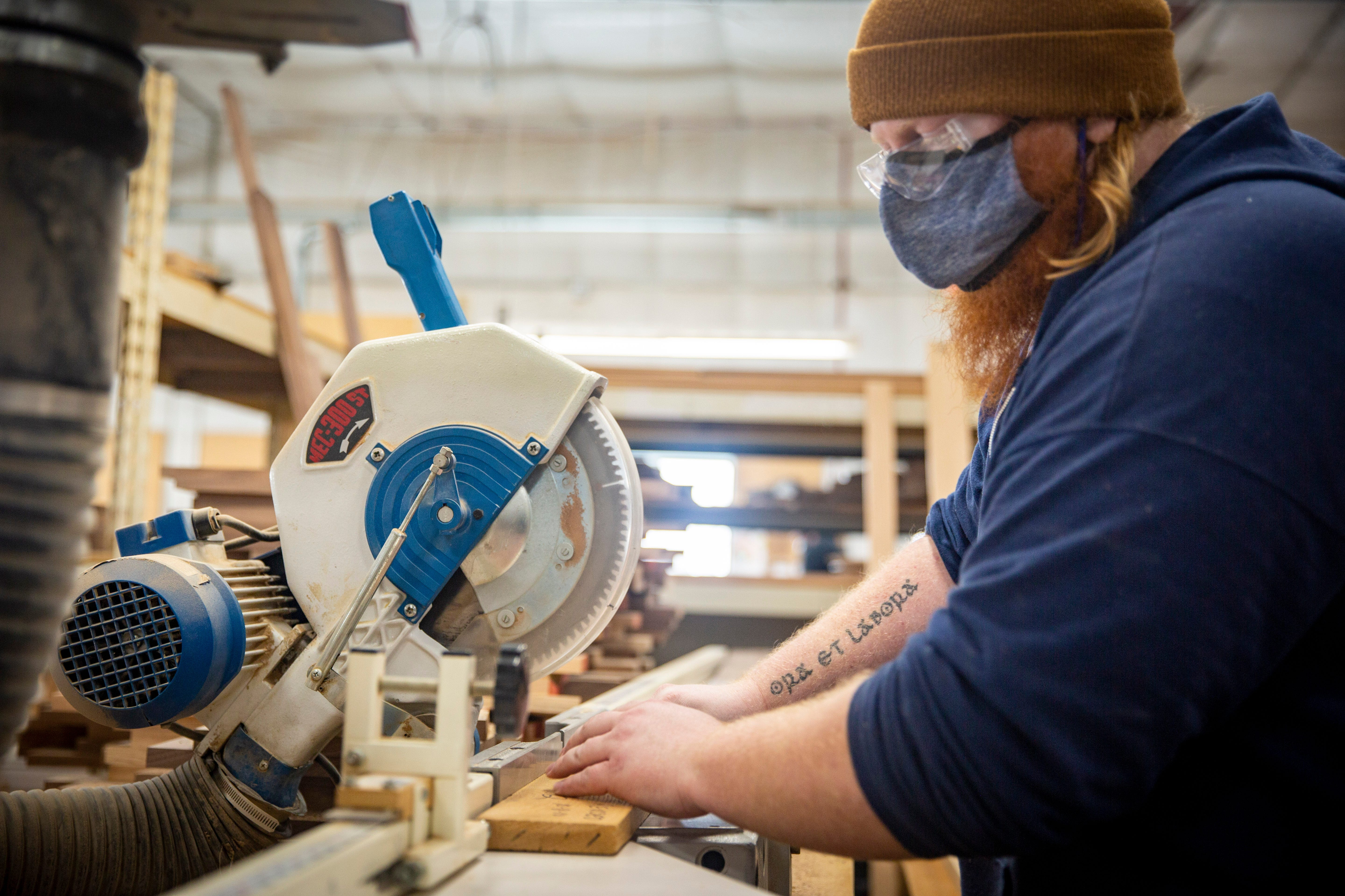 """James Knight thought he was taking a job building cabinets, not caskets. Now, he has the monks' motto tattooed on his forearm: """"Ora et Labora."""" Pray and Work."""