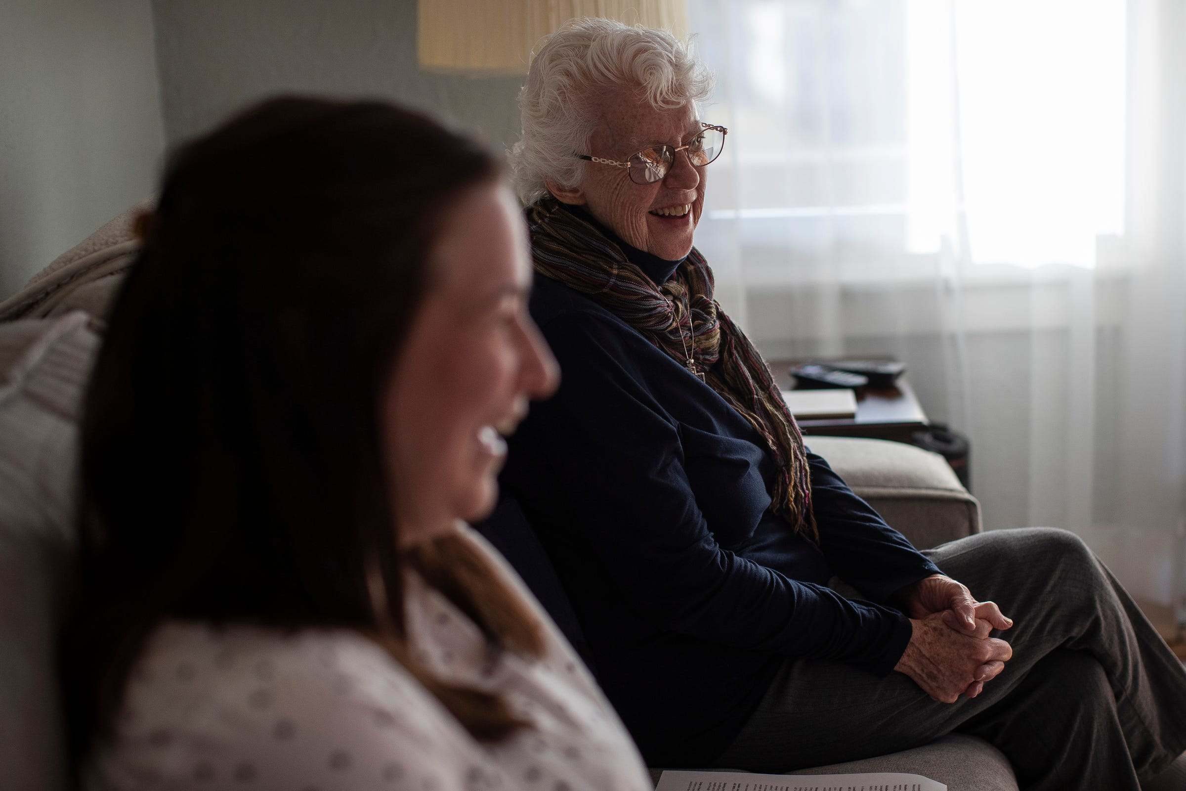 Sister Marcella Clancy shares a laugh with Sister Erin McDonald as they celebrate Saint Joseph's Day at their apartment in Detroit on March 19, 2021.