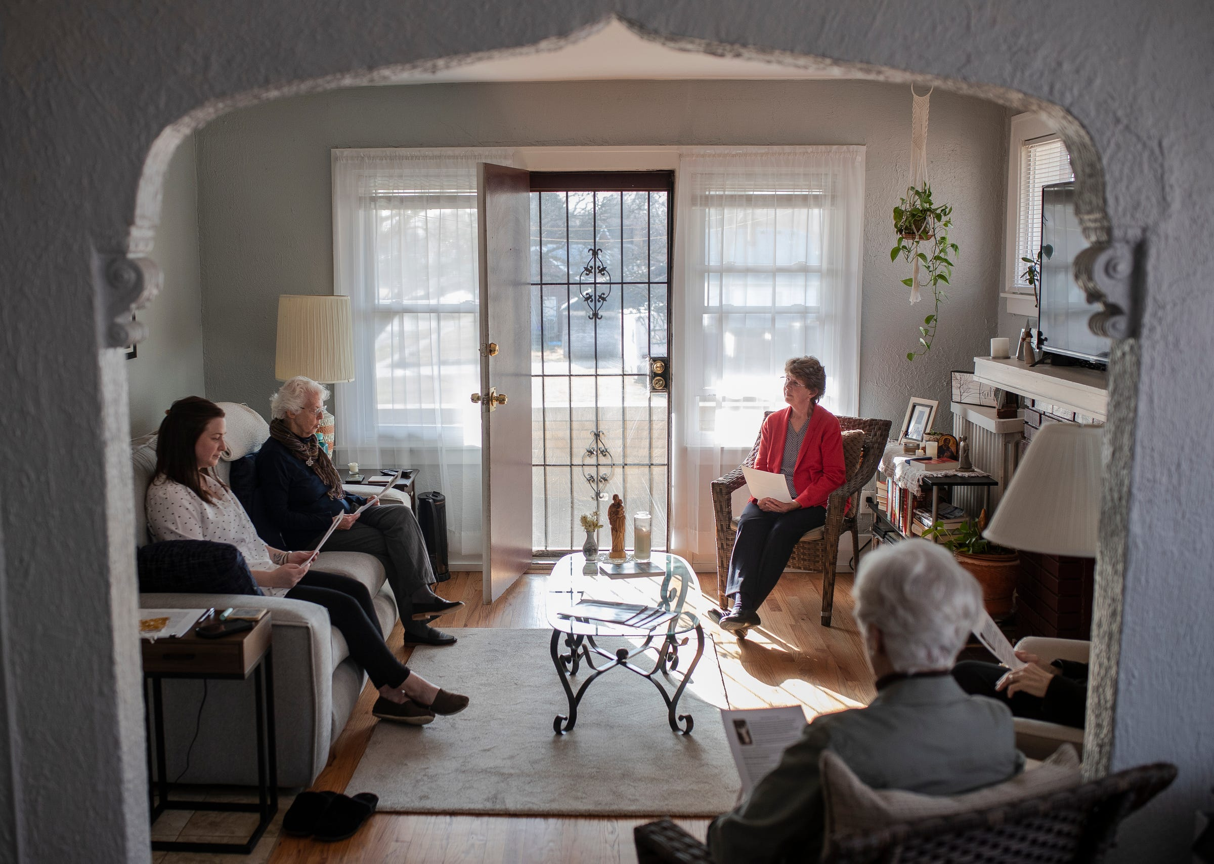 From left, Sister Erin McDonald, Sister Marcella Clancy, Sister Marie Hogan, Sister Jeanne Gamache and Sister Marie Benzing pray together to celebrate Saint Joseph's Day at Sister Erin McDonald and Sister Marcella Clancy's apartment in Detroit on March 19, 2021.