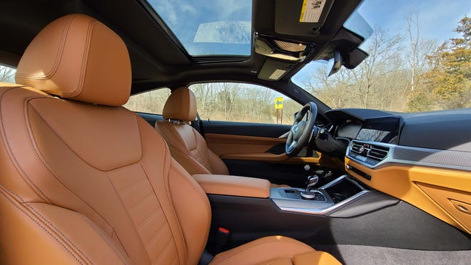 The interior of the 2021 BMW M440i is a comfortable place to be with leather seats, sunroof, and layers of digital tech.