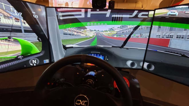 """Behind the wheel of a Porsche GT3 simulator at The Henry Ford's """"Driven to Win: Racing in America"""" exhibit."""