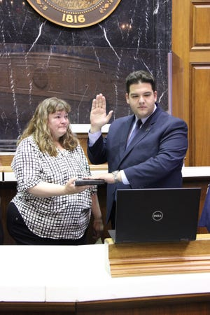 State Rep. Tim O'Brien (R-Evansville) (right), joined by his mother Cassy O'Brien (left), is sworn into office by Chief Justice Loretta H. Rush via Zoom Tuesday, March 30, 2021, while in the House Chamber at the Statehouse in Indianapolis. O'Brien will serve as the state representative for House District 78, which includes portions of Vanderburgh and Warrick counties.