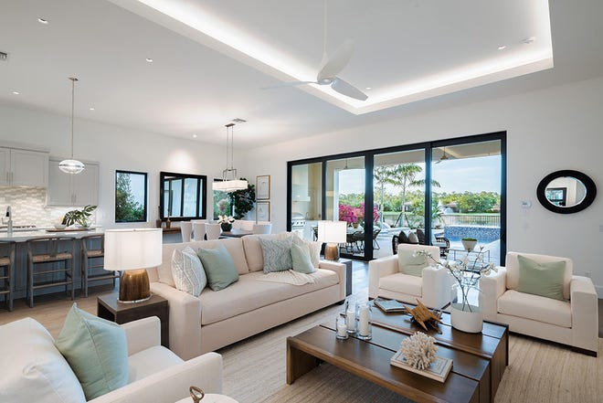 The Cameron's blended dining and living space opens to an expansive outdoor living area complete with a pool bath.