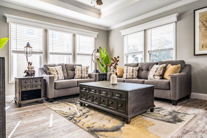 The living room in this Perry model has space for two couches, a table and the television. The tiny houses can even have decorated tray ceilings.