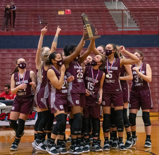 The Henderson County Lady Colonels celebrate at mid-court after beating the Union County Bravettes in their Second Region Tournament  championship  game at Hopkins County Central High School Monday, March 29, 2021.