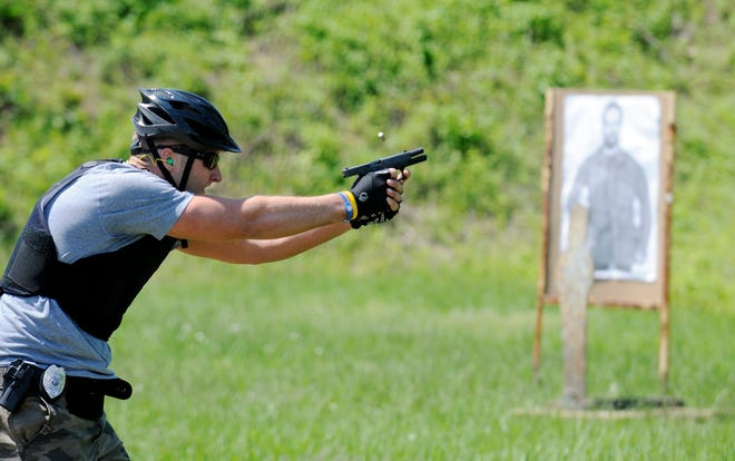 In this 2011 file photo, HPD's Jerad Shehorn fires rounds into targets during HPD's Bike School at the department's shooting range. (Gleaner photo by Darrin Phegley)