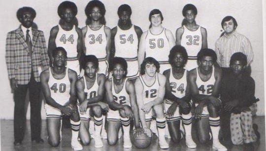 Mike Woodson (No. 44) stands with his Broad Ripple High School team. Coach Bill Smith stands to his left.