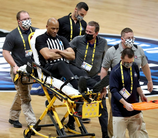Official Bert Smith is rolled off the court on a stretcher after collapsing on the court during a game between Gonzaga and USC in the Elite Eight round of the 2021 NCAA Tournament on Tuesday, March 30, 2021, at Lucas Oil Stadium in Indianapolis, Ind.