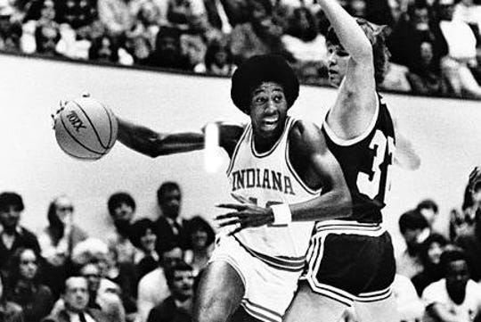 Indiana University's Mike Woodson drives around Washington's Stan Walker during the championship game of the Indiana Classic in Bloomington, December 19, 1978.